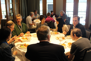 Affiliate colleagues in conversation over lunch at JSM 2018