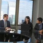 three people around a conference table