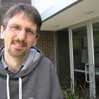 John Aston standing outside of the NISS building