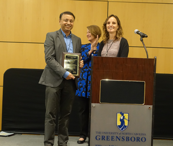 Sujit Ghosh (NC State) receiving distinguished NC-ASA service award.