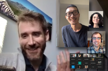 Ben Risk (left) and Ark Fang (center) speak with students at a Graduate Student Network meetup.