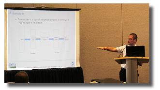 Sartore emphasizing a point at a presentation at JSM 2018