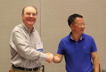David Banks, SAMSI Director and Zhang Riquan, East China Normal University shaking hands.