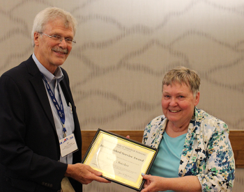 Mary Batcher receives the NISS Distinguished Service Award at the NISS/SAMSIreception.