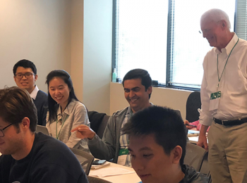 R & Spark Instructor, Jim Harner (right), with students.