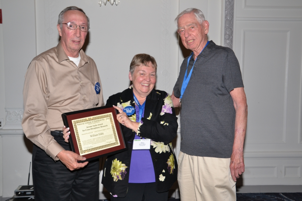 Mary Batcher, Chair of the National Institute of Statistical Sciences Board of Trustees awards William Eddy with the Jerome Sacks Award for Cross-Disciplinary Research at the 2016 NISS-JSM Awards Reception [Photo courtesy of the ASA]