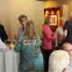 Forum participants continue conversation at reception
