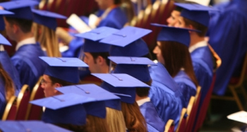 people in blue graduation caps