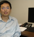 Xingdong Feng in his office